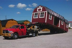 Truck pulling a big portable building